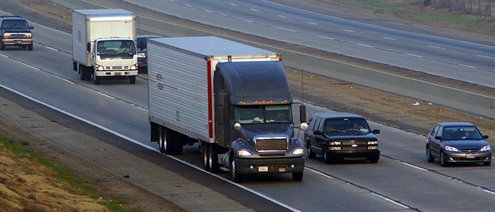 semi truck driving on interstate